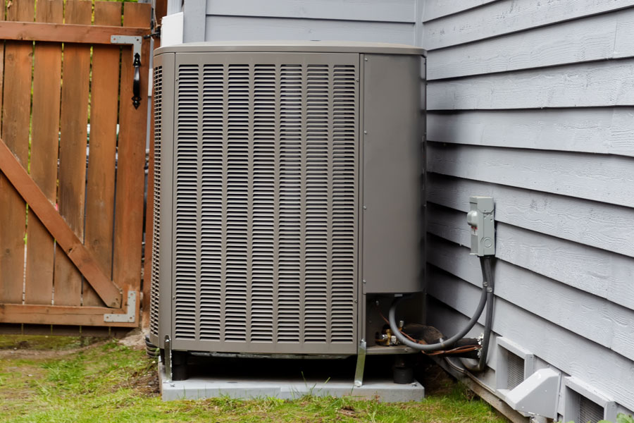 Energy heat pump on residential home for heat and air conditioning. Ample Services Air Conditioning Service Repair Near Katy, TX.